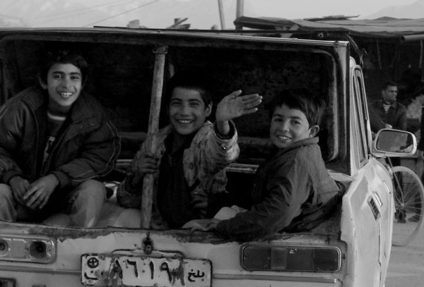afghan boys riding cheap in the taxi boot