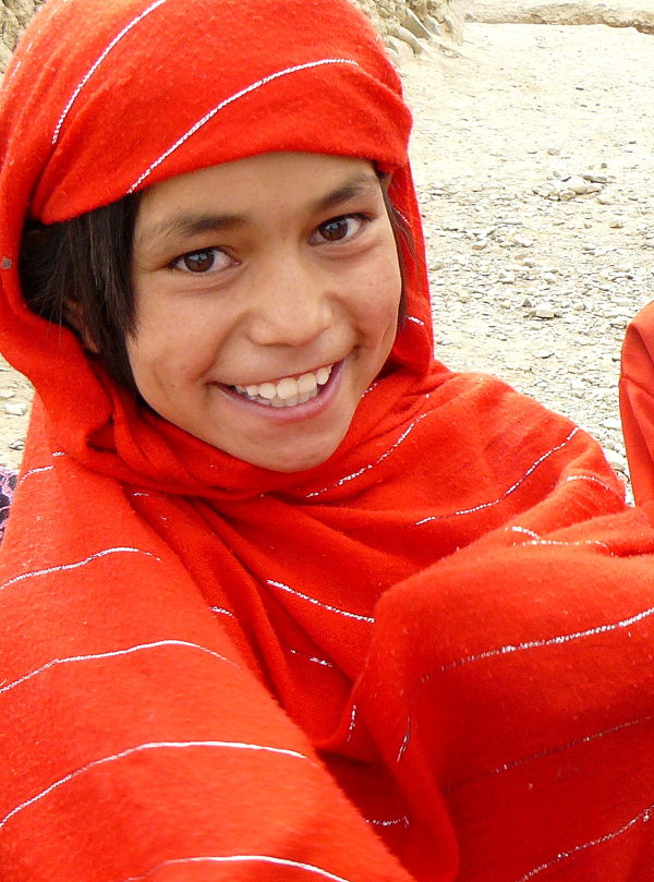 Young afghan girl in red