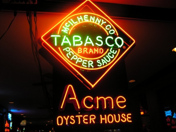 A lighted sign at Acme Oyster House