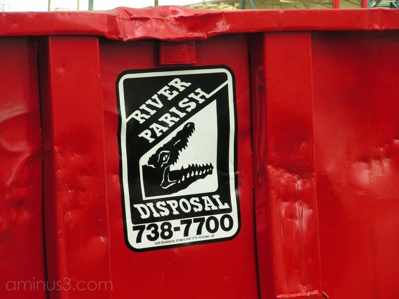 Waste disposal box with gator sign.