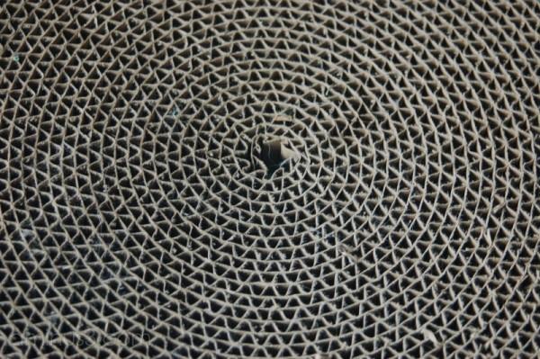 A corrugated cardboard disk