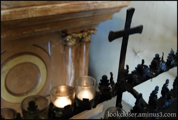 NOLA candles fire cross prayer faith light