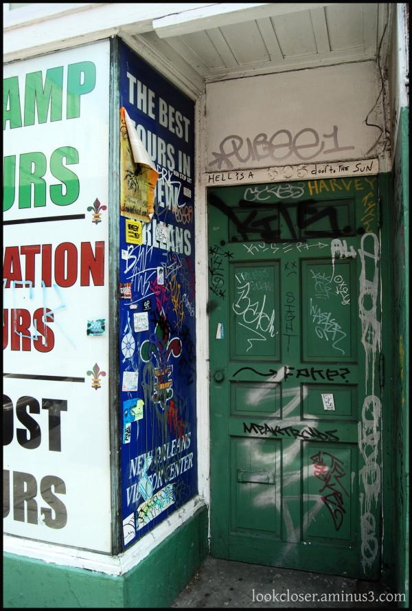 NOLA French-Quarter green door graffiti