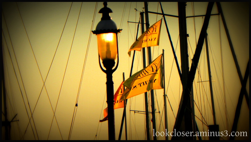 marina lantern sunset yellow flags