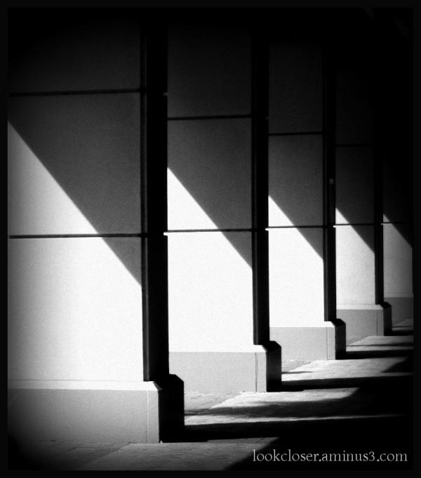 pillars shadows stone bw