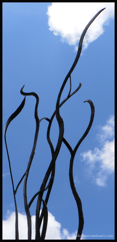 sculpture curls blue sky