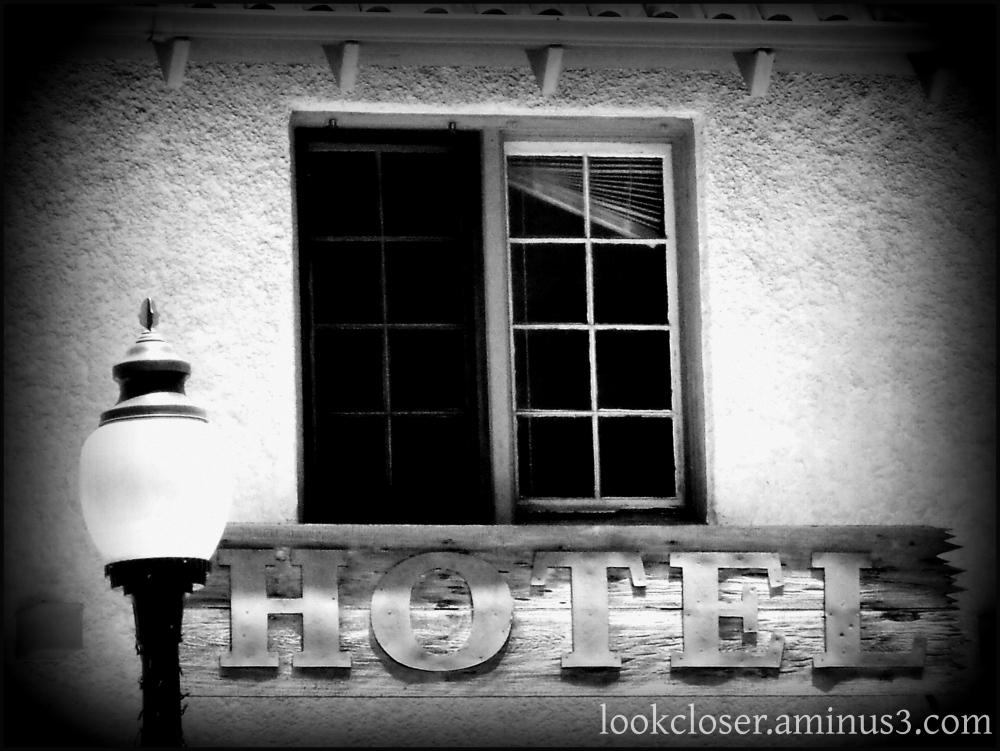 streetlight hotel winow shutters bw lomo