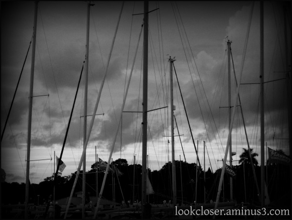 clouds sailboats masts bw storm