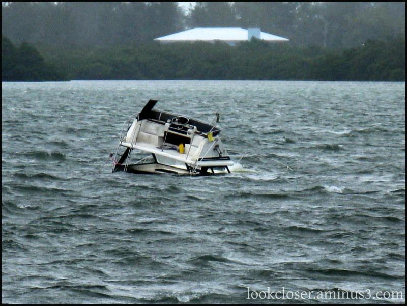 sunk boat isaac waves storm
