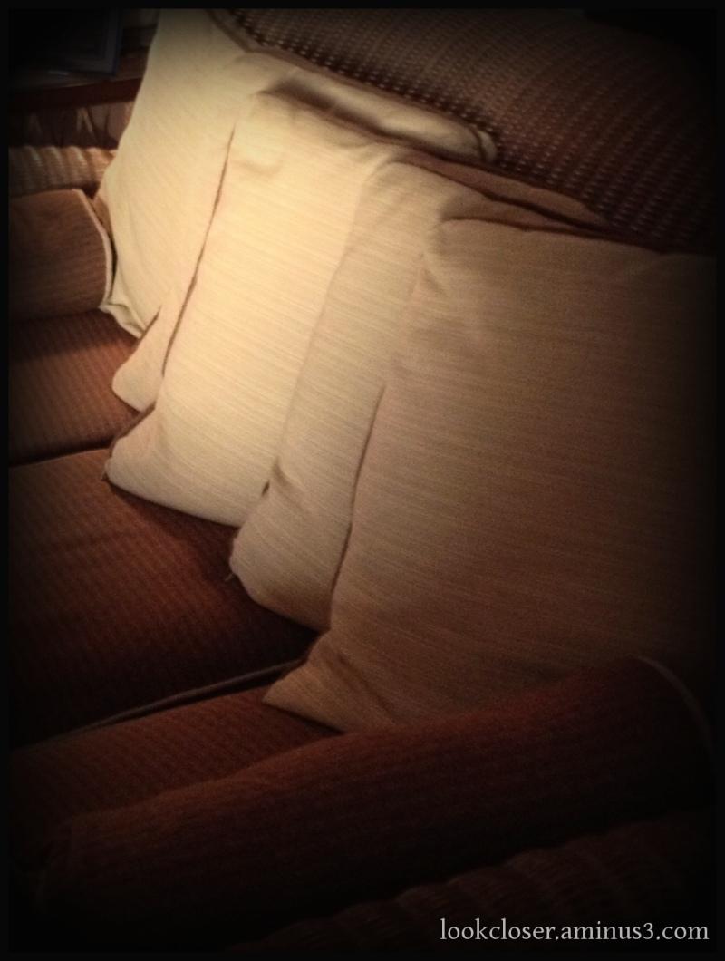 pillows gibson inn lobby brown sofa vignette