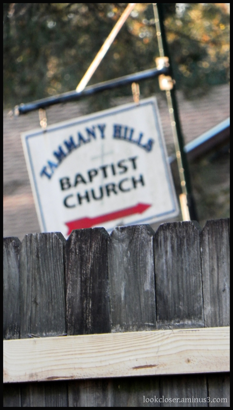 church sign red arrow wood fence