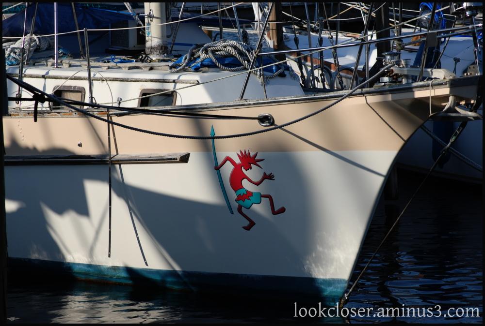 red dancing native boat marina