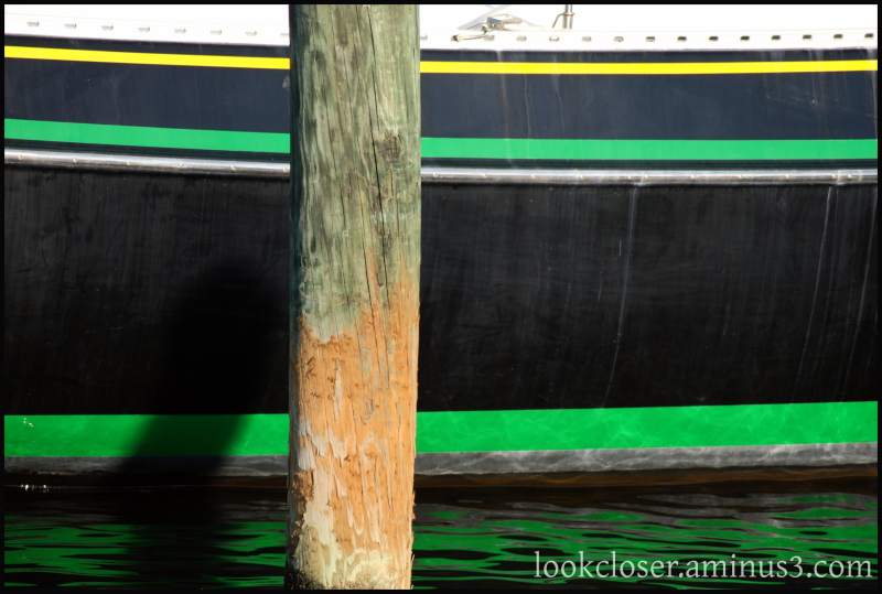 green stripes post water boat