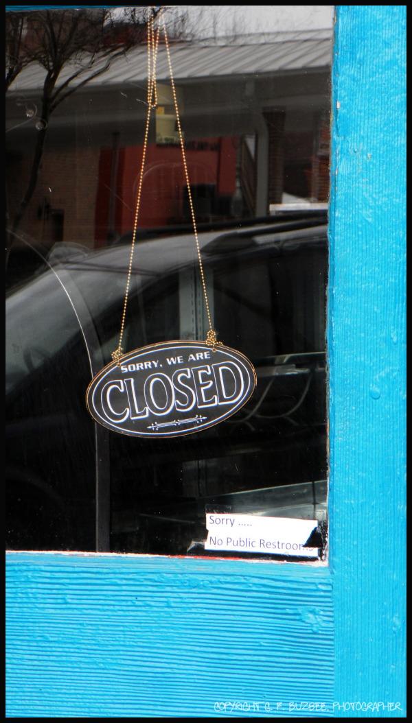 window sign closed blue door