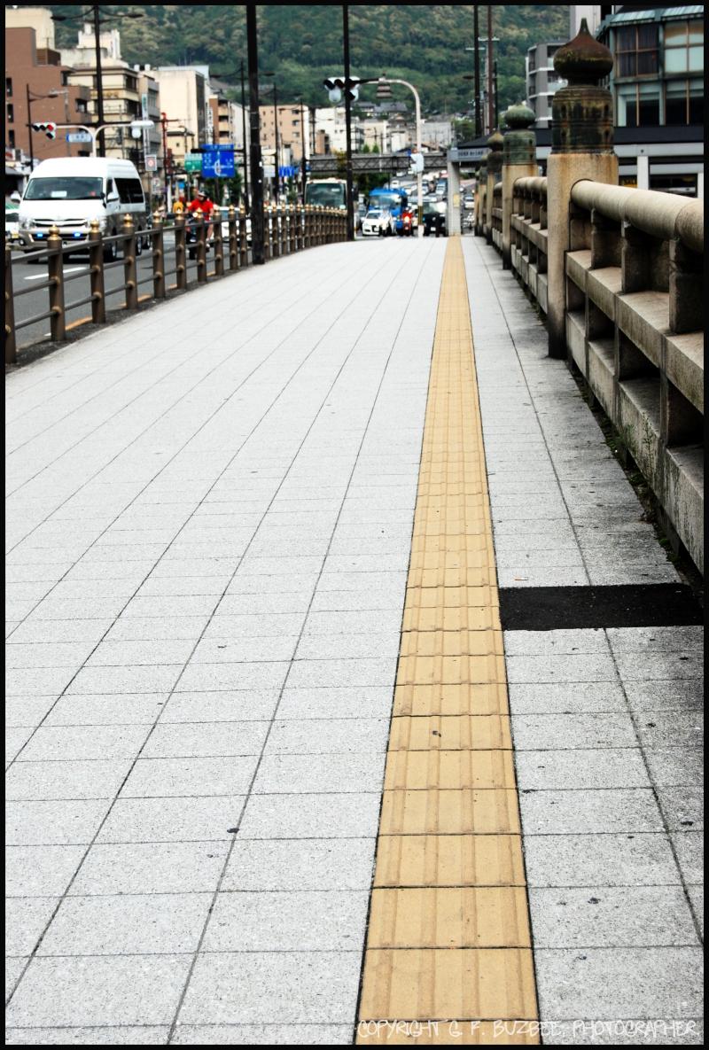 braille guide bridge street path Kyoto