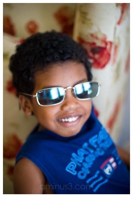 a boy with sunglass