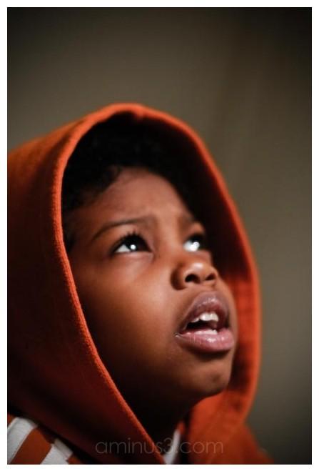 Kid in a orange hoodie