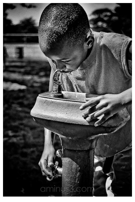 a young boy at the drinking fountain