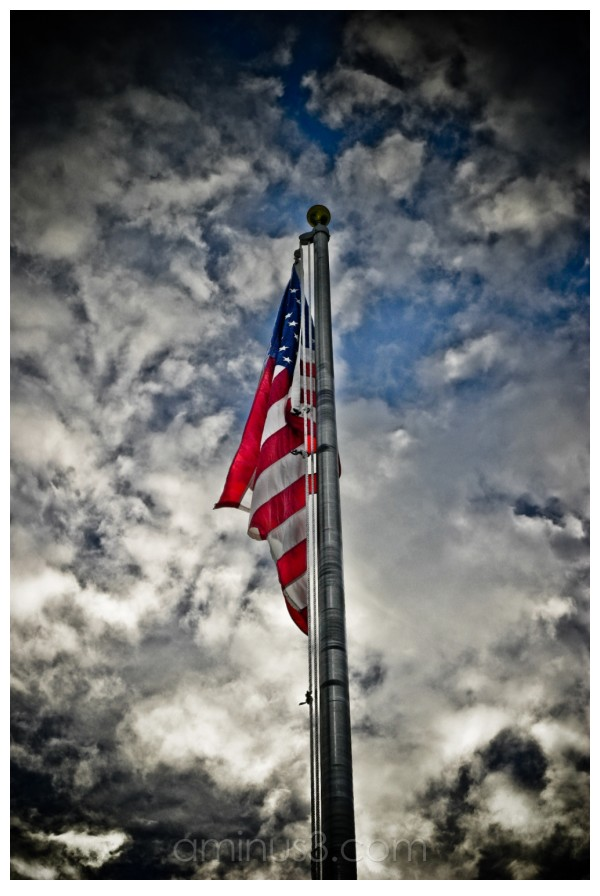 Flag in a stormy sky