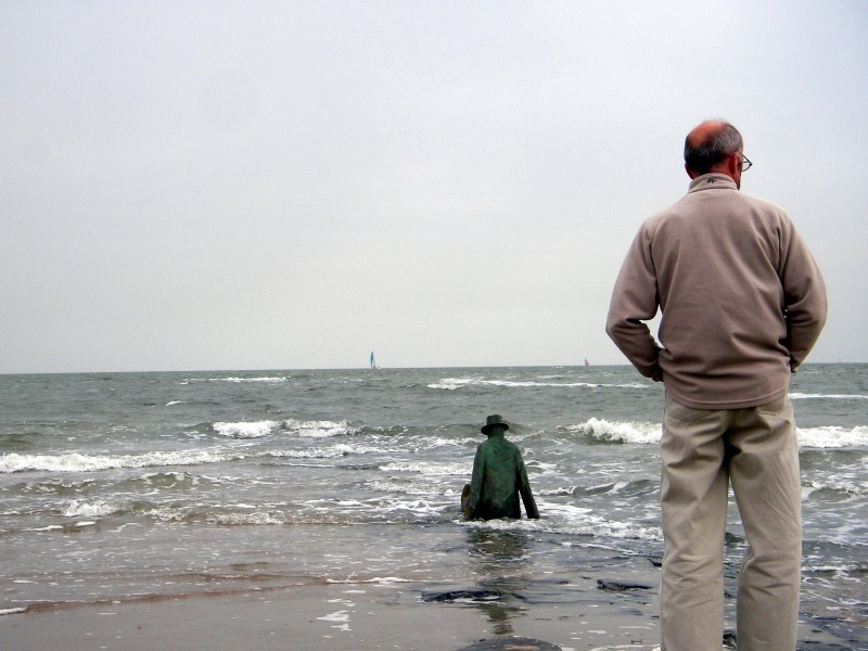 Man and statue at the beach