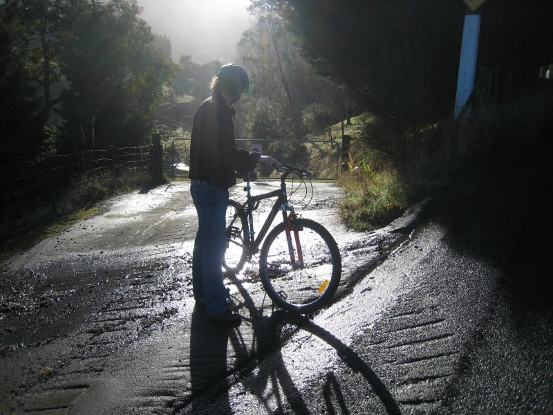 Backlit shot of a youth and bike