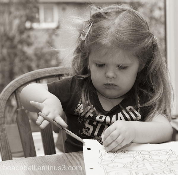 little girl cutting paper