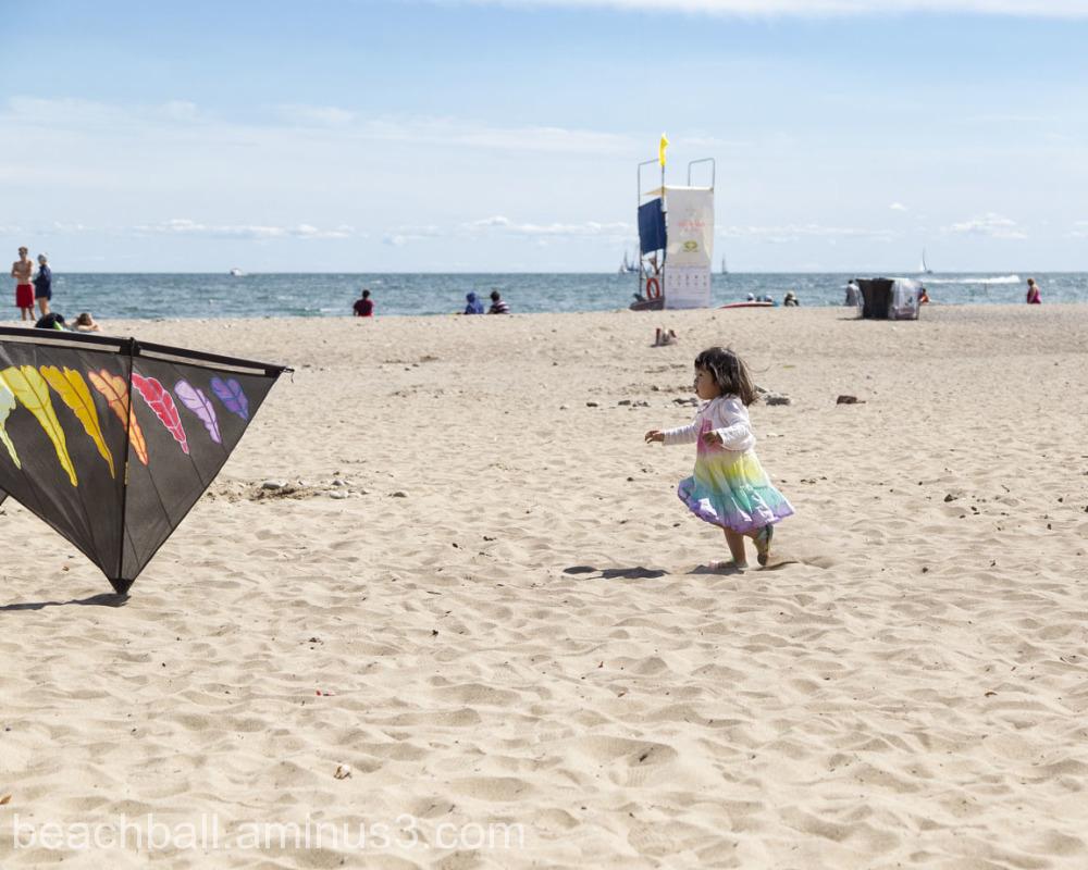 Little girl chasing a kite
