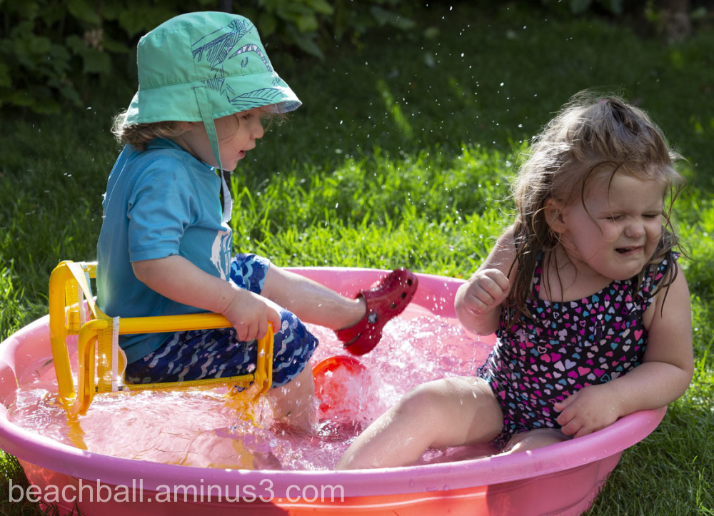 two children in a splash pool