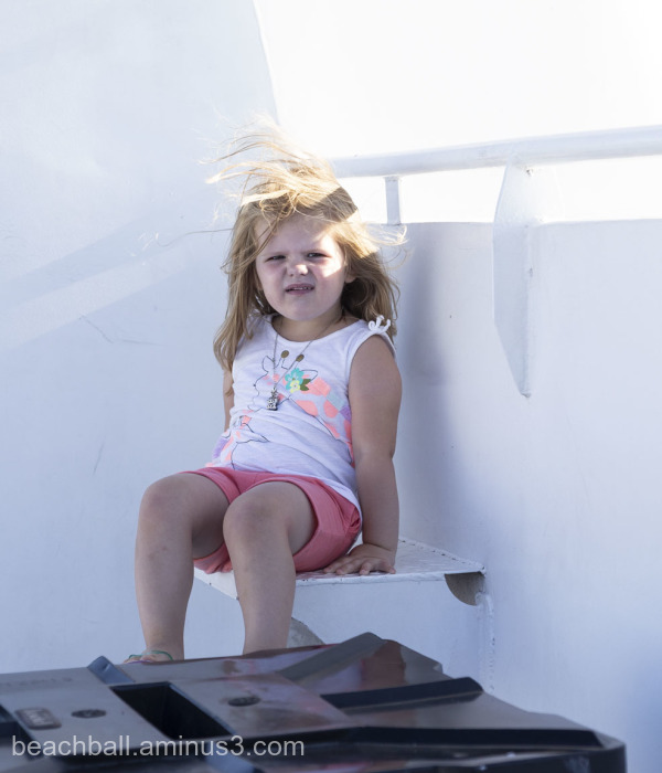 Little girl sitting on a ferry