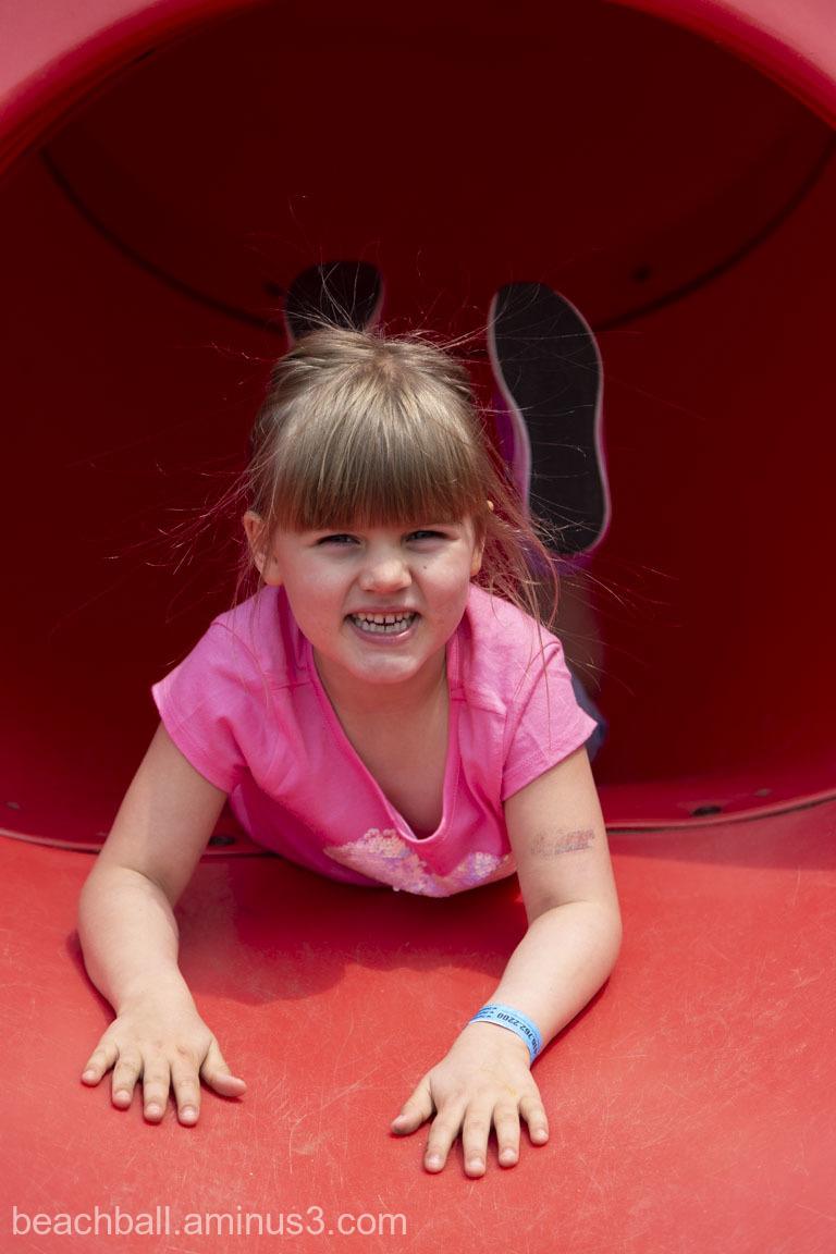 Girl inside an orange slide