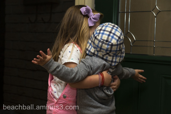 Little girl give a boy a hug