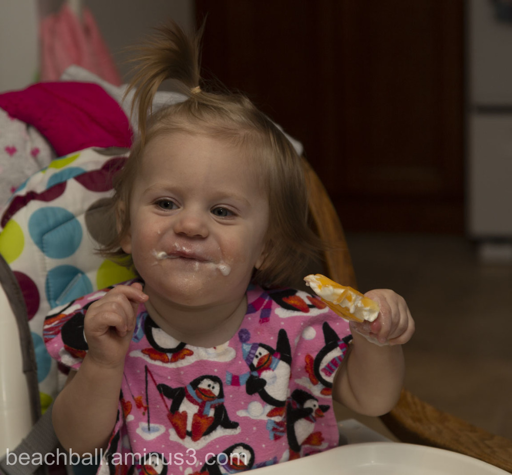 Little girl eating a creamsicle
