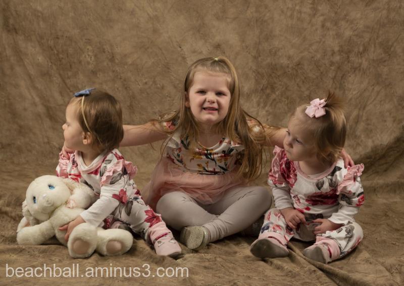 three children posing for the camera