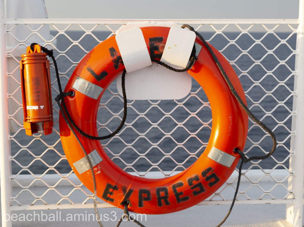 An orange life bouy on Lake Michigan ferry