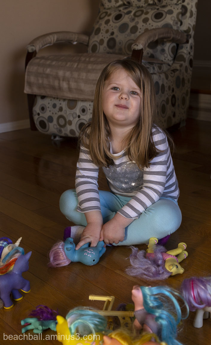 Little girl playing with my little ponies