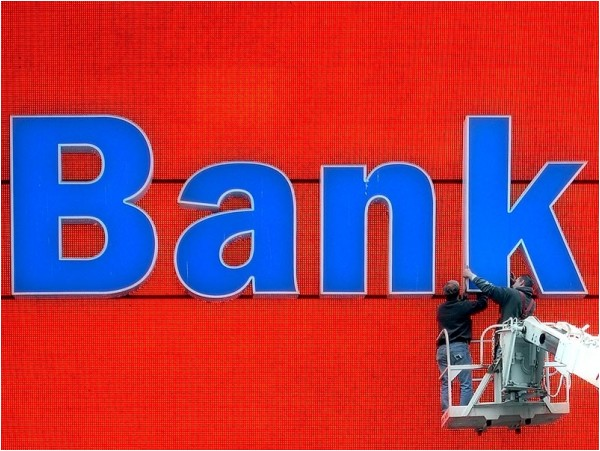 Cleaning the sign at Bank of America
