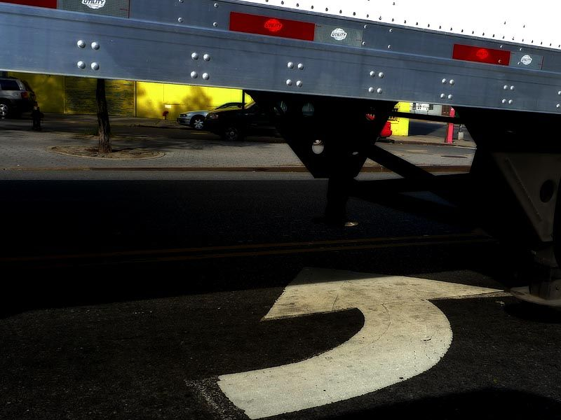 Under a truck, turning