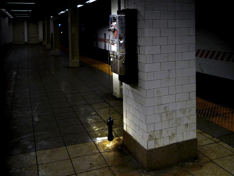 Hanging phone on Canal Street station