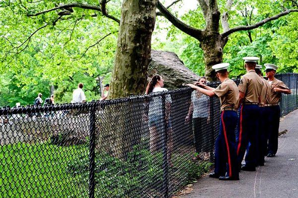 Men in uniform and ladies in the park
