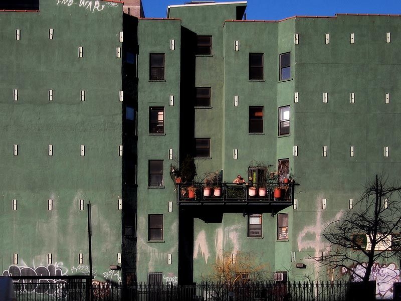 Grafitti on green building on Houston Street