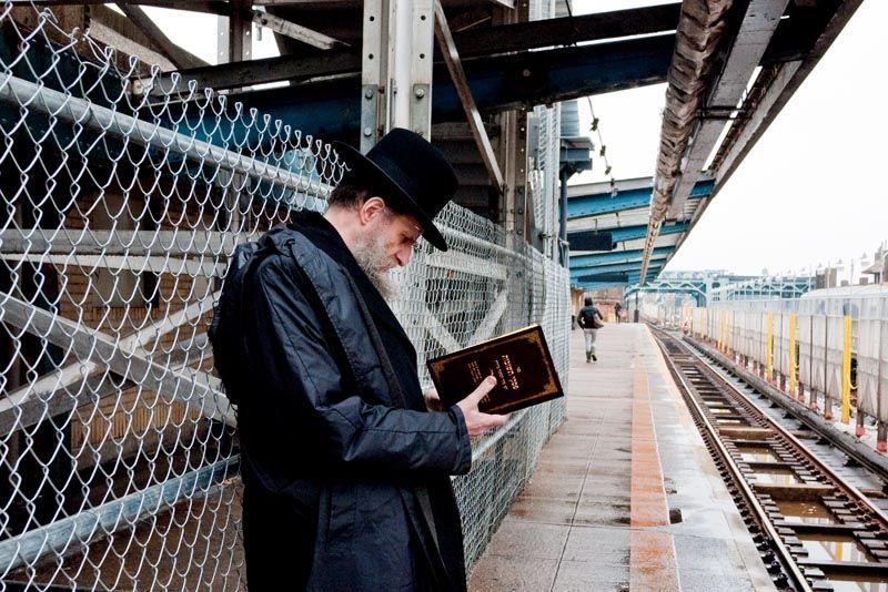 Prayer before a train ride on Fourth Avenue