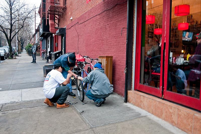 Repairing a bicycle on Fifth Avenue, Brooklyn