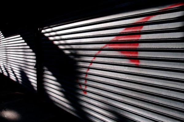 Shadow on roll down window in Williamsburg