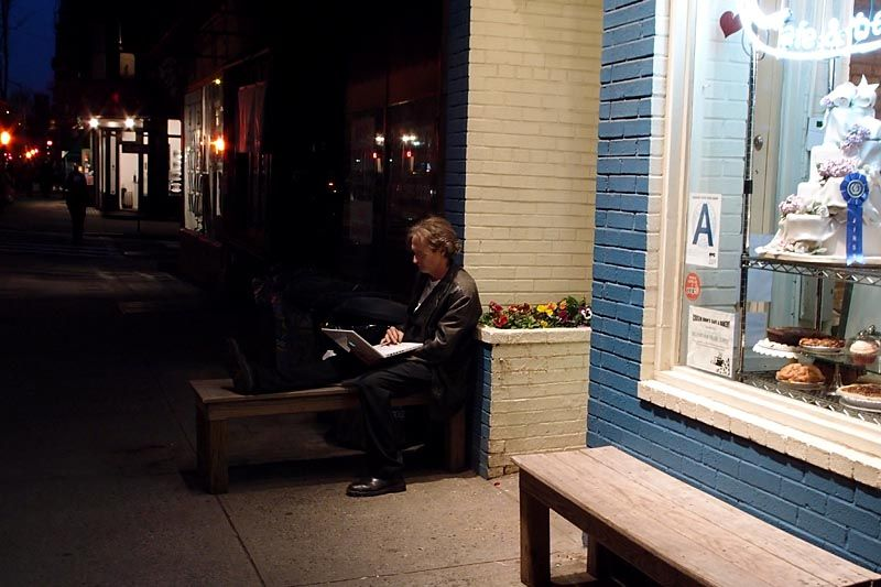 Using a Macbook Pro in front of a patisserie