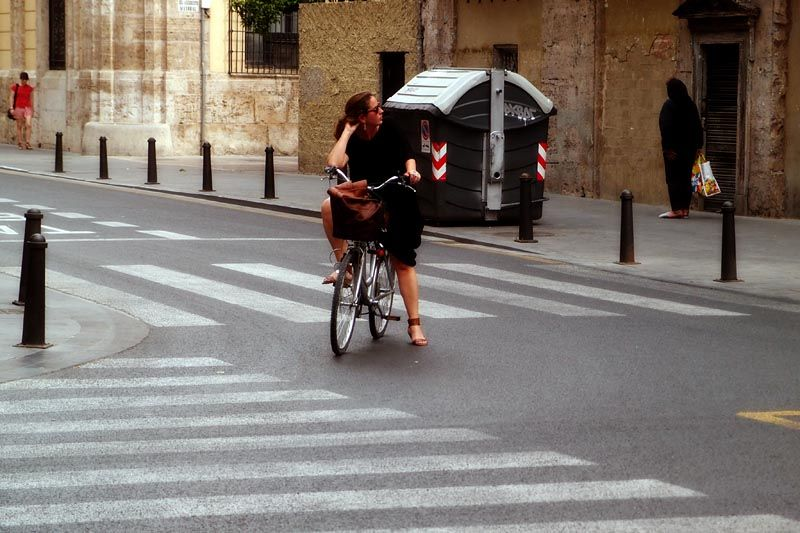 Bicycling woman in Valencia, Spain