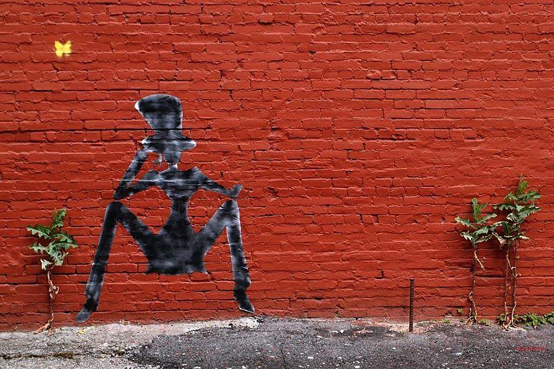 Making art on an empty lot wall in SoHo
