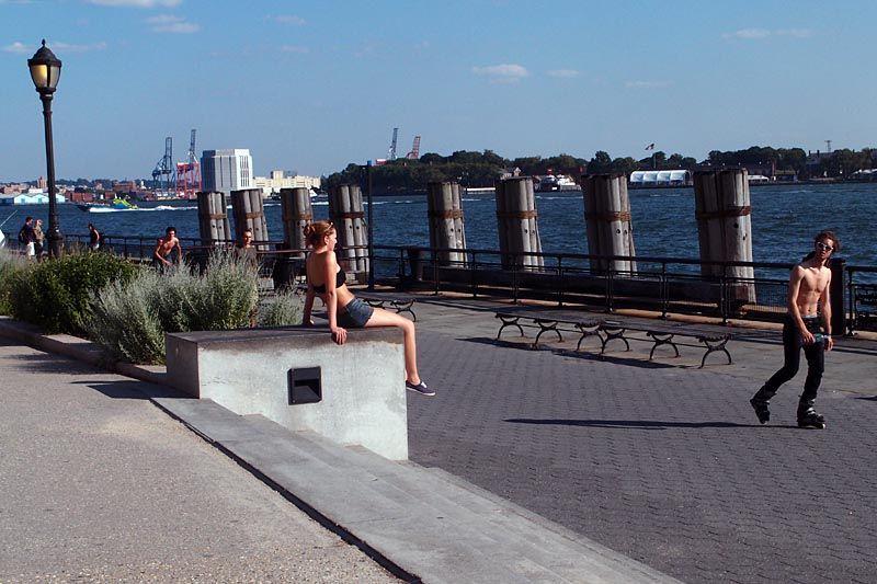 Girl and skater flirting on Battery Park