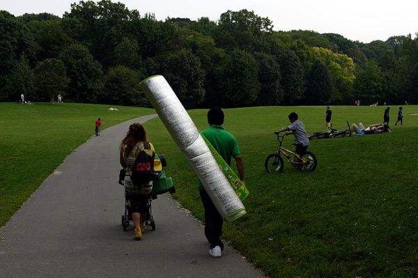 Carrying a silver picnic blanket in Prospect Park