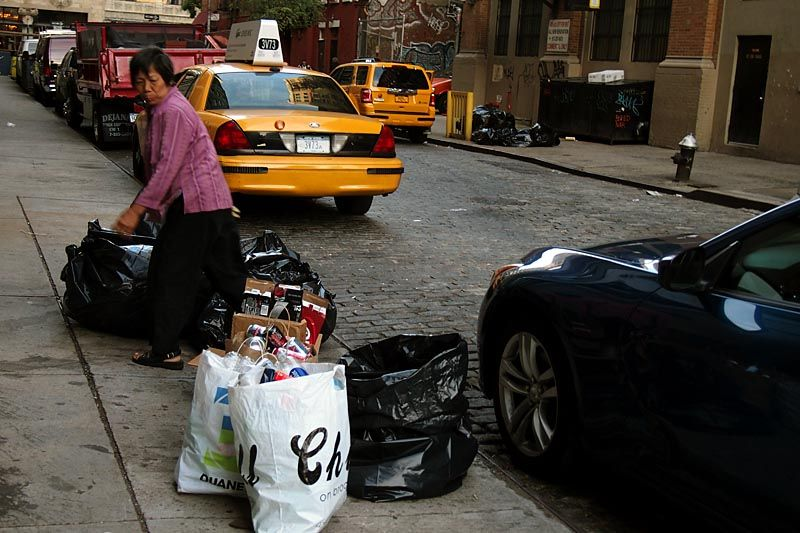 Woman surveying the garbage on Jones Alley