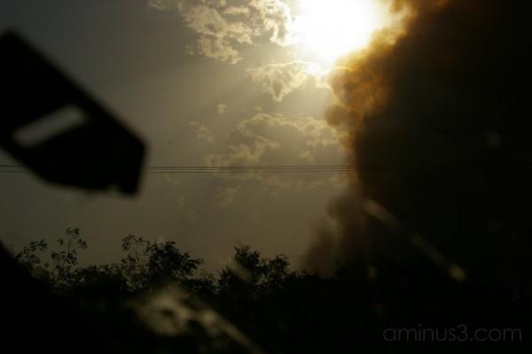 Forest fire smoke eats the sun